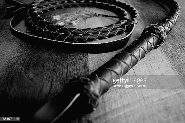 Close-Up Of Bullwhip On Table