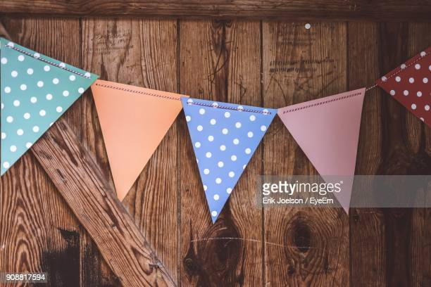 Close-Up Of Bunting Against Wooden Wall