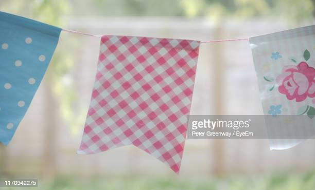 close-up of buntings hanging against blurred background - bicester village stock pictures, royalty-free photos & images
