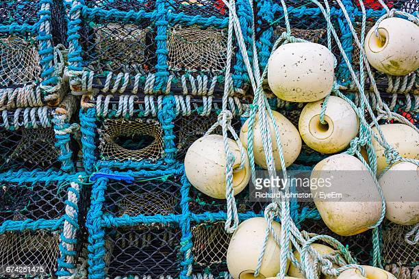 Close-Up Of Buoys Hanging From Lobster Traps