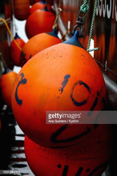 Close-Up Of Buoys Hanging On Boat