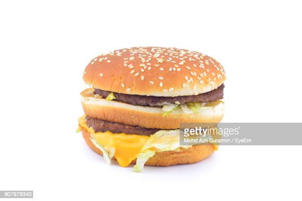 close-up of burger against white background - take away food stock pictures, royalty-free photos & images
