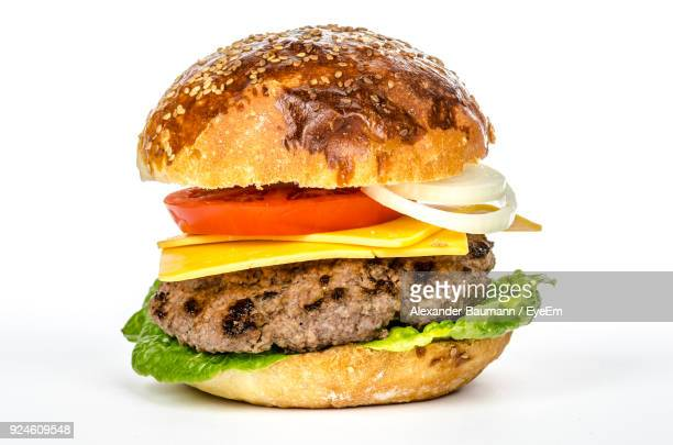close-up of burger against white background - cheeseburger stock pictures, royalty-free photos & images