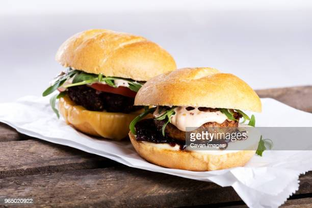 close-up of burger on paper - mayonnaise stock photos and pictures