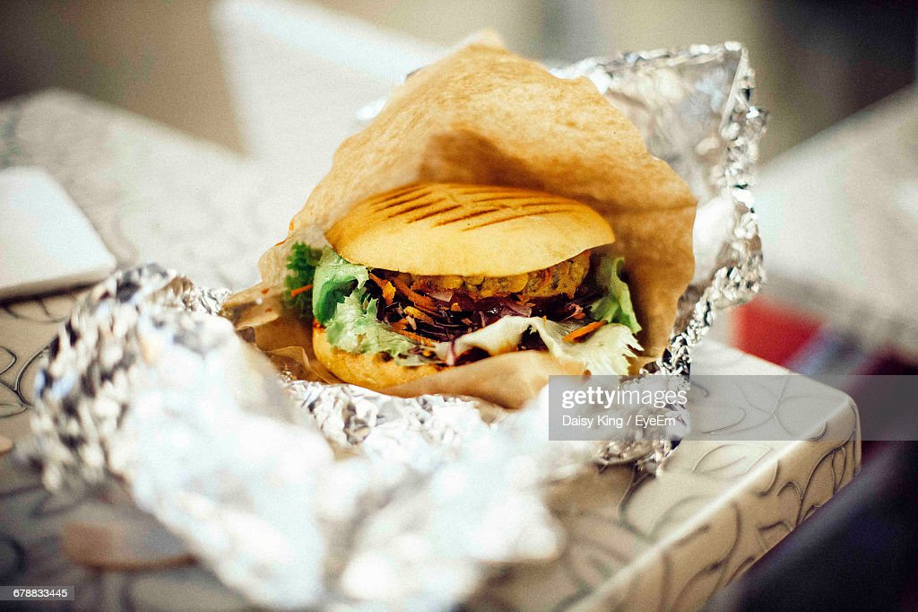 Close-Up Of Burger On Table : Stock Photo