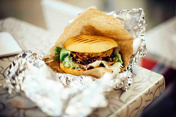 close-up of burger on table - burger king stock pictures, royalty-free photos & images