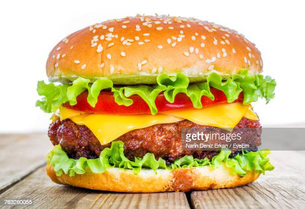 close-up of burger - cheeseburger stock pictures, royalty-free photos & images