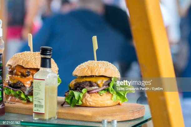 Close-Up Of Burgers On Cutting Board