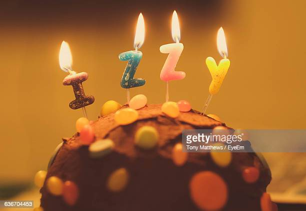 Close-Up Of Burning Birthday Candles On Cupcake