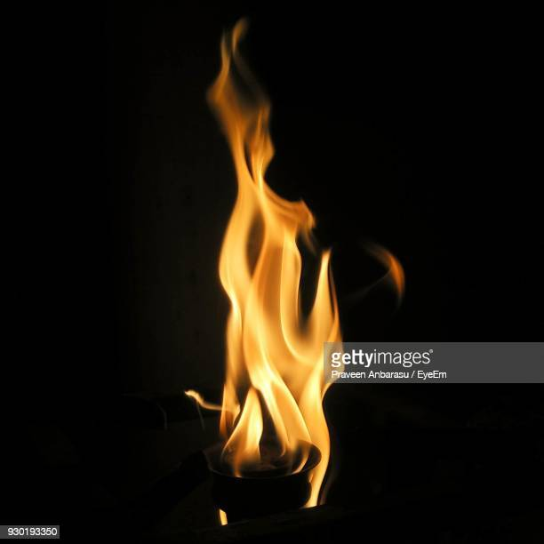 close-up of burning candle against black background - fire natural phenomenon stock pictures, royalty-free photos & images