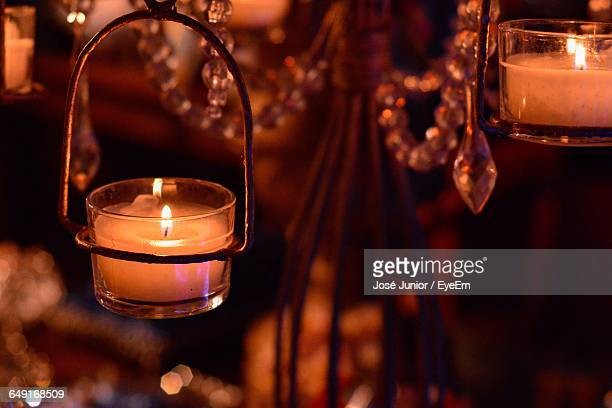 close-up of burning candle in darkroom - brazilian waxing stock photos and pictures