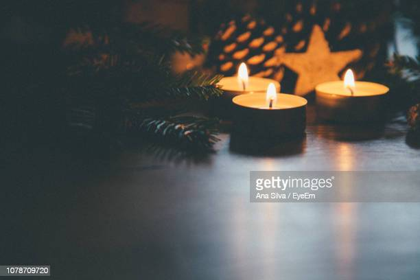 Close-Up Of Burning Candles During Christmas