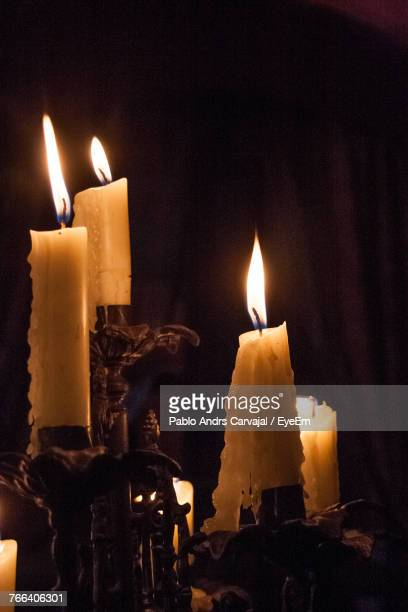 close-up of burning candles in darkroom - carvajal stock photos and pictures