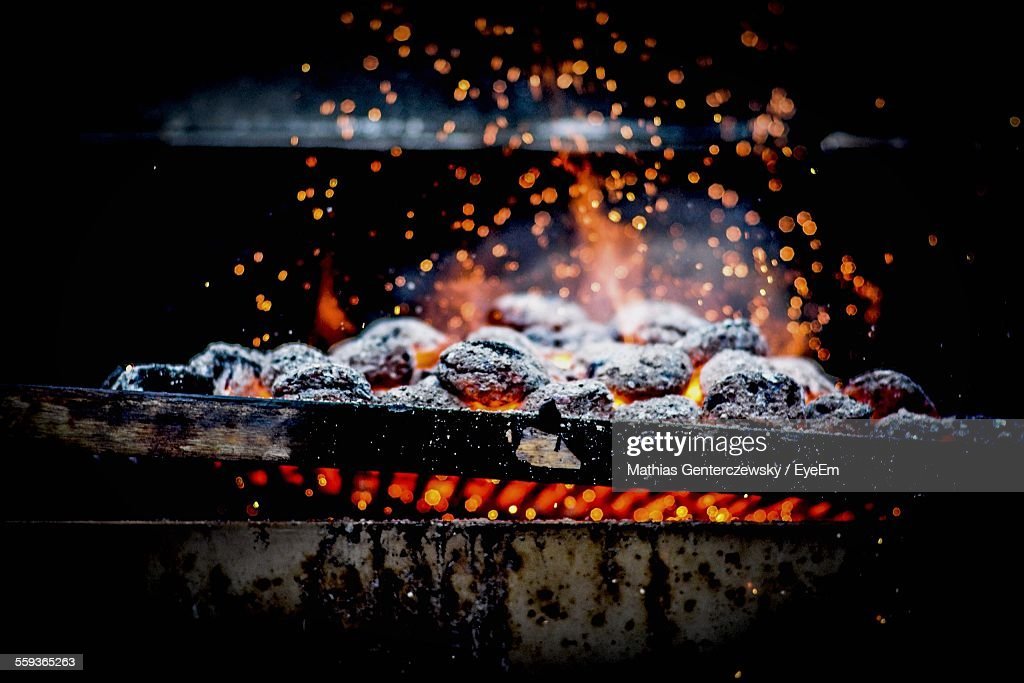Close-Up Of Burning Coal On Metal Grill : Stock Photo