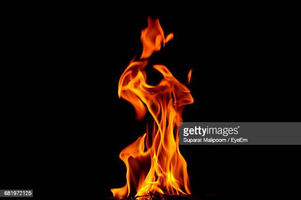 Close-Up Of Burning Fire Against Black Background