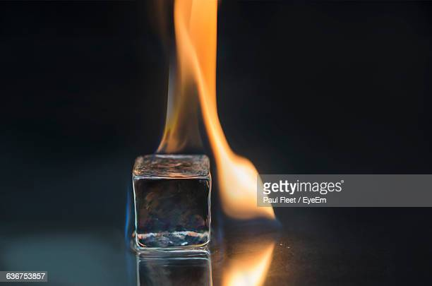 Close-Up Of Burning Ice Over Black Background