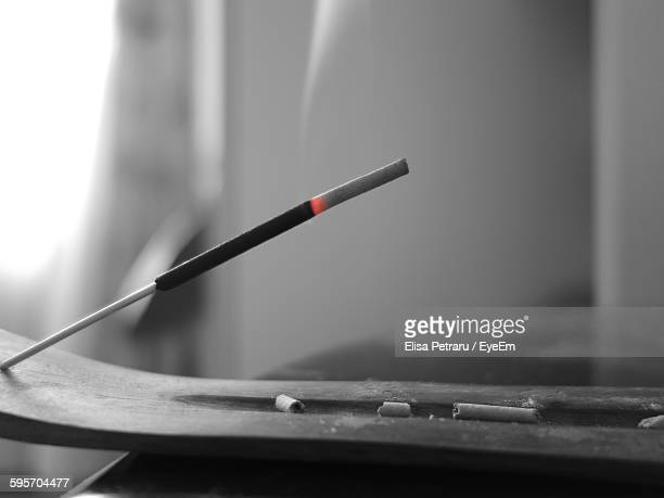 close-up of burning incense stick - incense stock photos and pictures