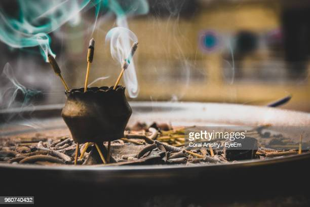 close-up of burning incenses amidst smoke - incense stock photos and pictures
