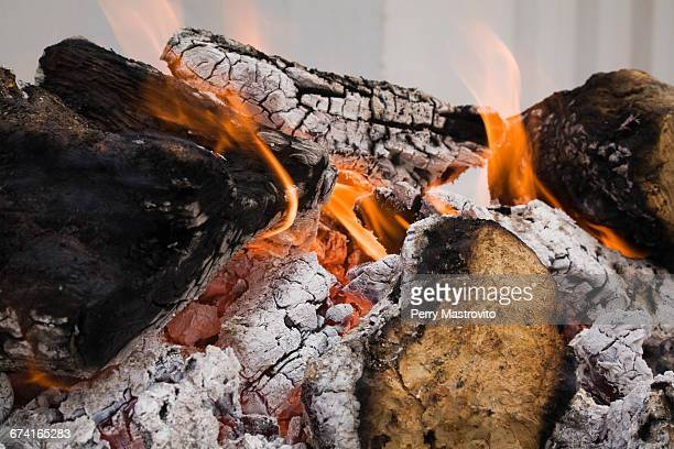 Close-up of burning wood in a barbecue pit