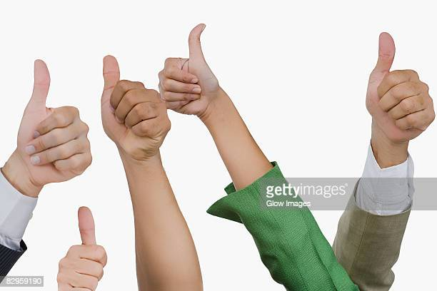 close-up of business executives showing thumbs up sign - long sleeved stock pictures, royalty-free photos & images