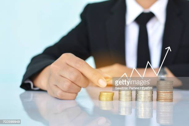 Close-Up Of Business Man Holding Coin