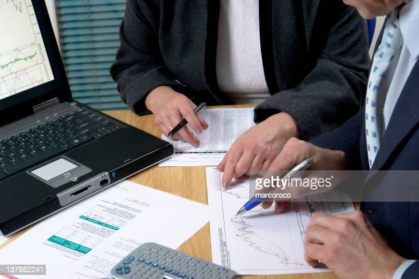 close-up of business meeting with two men - rating stock photos and pictures