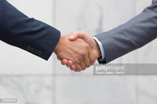 close-up of business people shaking hands - 握手 ストックフォトと画像