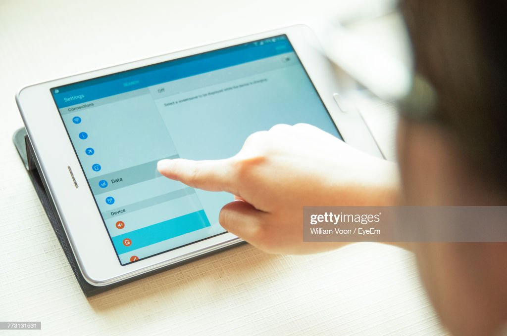 Close-Up Of Business Person Using Digital Tablet In Office : Photo