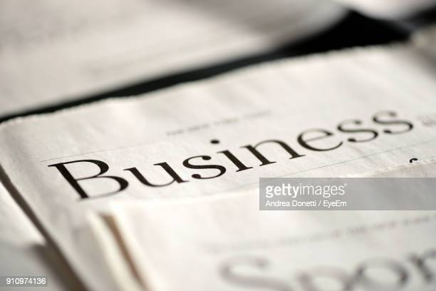 close-up of business text on newspaper - western script stock pictures, royalty-free photos & images