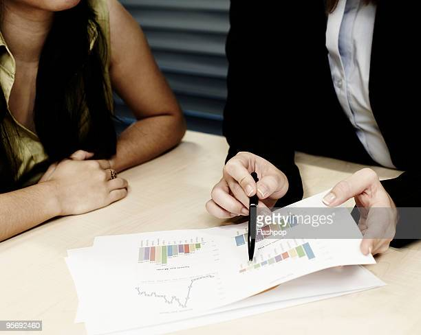 Close-up of business women looking at charts