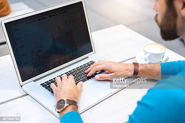 close-up of businessman analyzing data on laptop display - computer screen stock photos and pictures