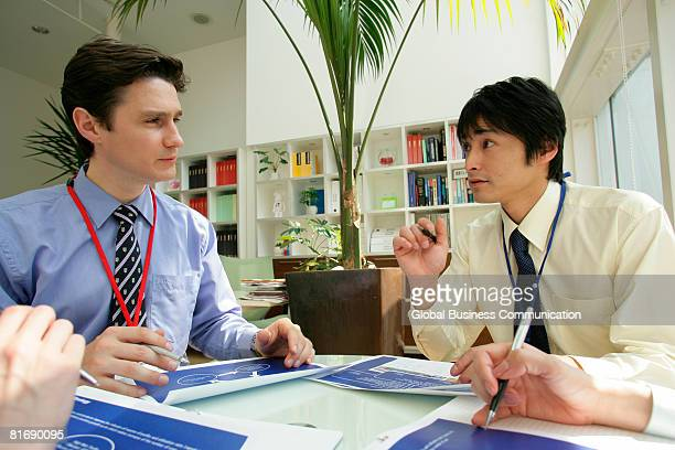Close-up of businessman and female colleague