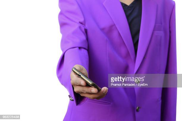 Close-Up Of Businessman Using Mobile Phone Against White Background