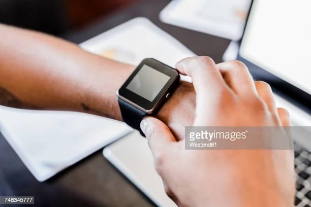 Close-up of businessman wearing smartwatch