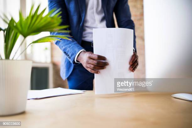 close-up of businessman with papers at desk in office - neat stock pictures, royalty-free photos & images