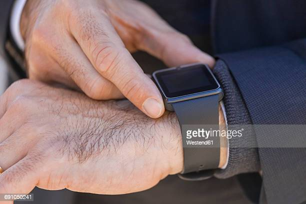 close-up of businessman with smartwatch - wrist watch stock pictures, royalty-free photos & images