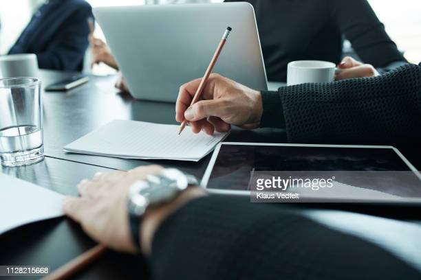 close-up of businessmans hands, writing on note block - manager stock pictures, royalty-free photos & images