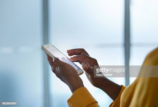 close-up of businesswomans hands holding phone - mobile app stock pictures, royalty-free photos & images
