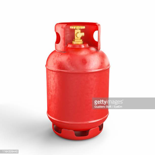 close-up of butane cylinder against white background - flammable stock photos and pictures