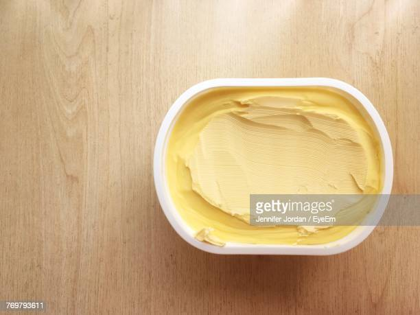 close-up of butter in container on table - butter stock pictures, royalty-free photos & images