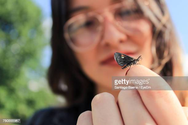 Close-Up Of Butterfly On Finger