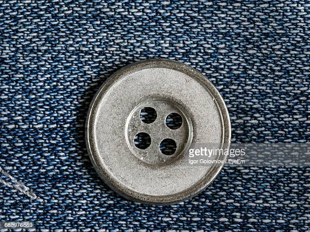 Close-Up Of Button On Jeans