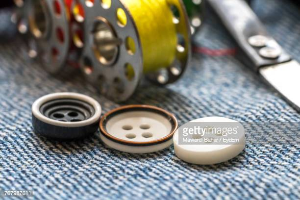 Close-Up Of Buttons And Sewing Item On Jeans