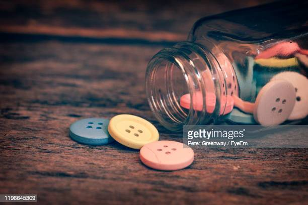 close-up of buttons on table - bicester village stock pictures, royalty-free photos & images