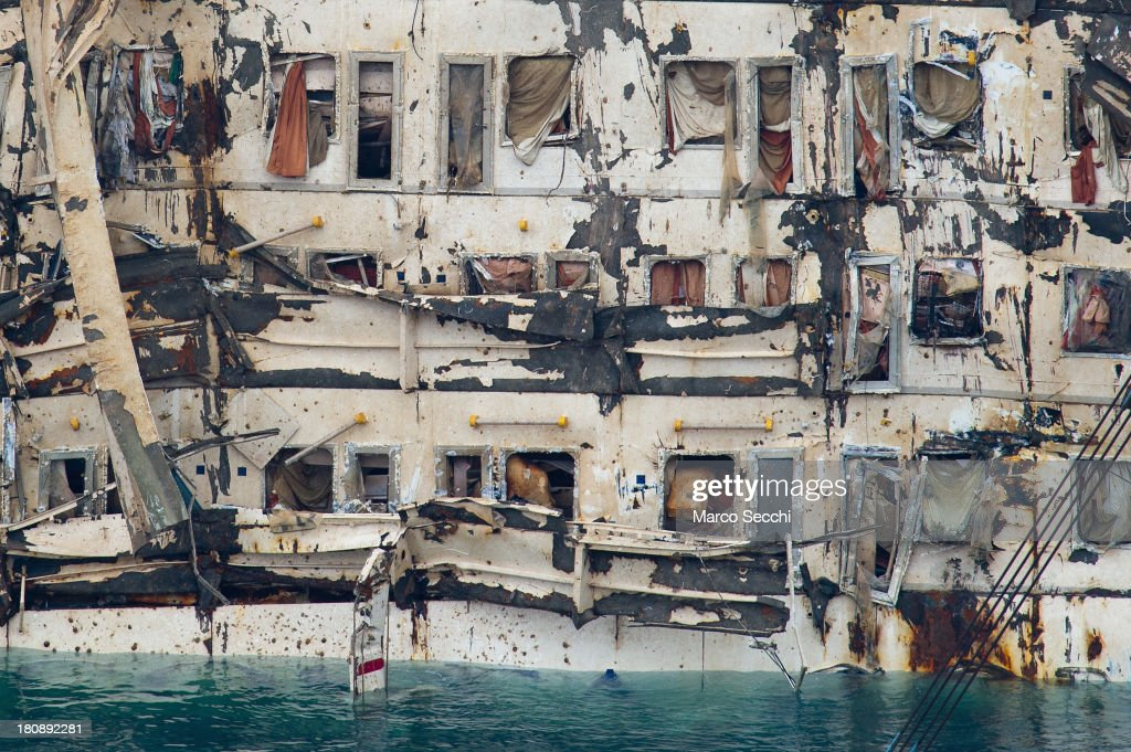 A close-up of cabins on the severely damaged side of the stricken Costa Concordia after the parbuckling salvage operation successfully uprighted the ship at around 4 am on September 17, 2013 in Isola del Giglio, Italy. Work began yesterday to right the stricken Costa Concordia vessel, which sank on January 12, 2012. If the operation is successful, it will then be towed away and scrapped. The procedure, known as parbuckling, has never been carried out on a vessel as large as Costa Concordia before.