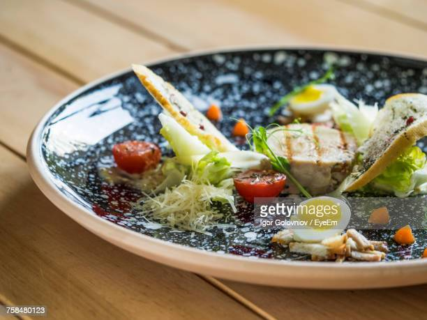 Close-Up Of Caesar Salad Served In Plate On Table