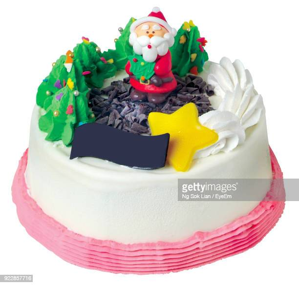 close-up of cake against white background - christmas cake stock photos and pictures