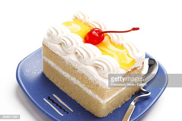 Close-Up Of Cake In Plate Against White Background