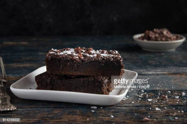 close-up of cake in plate on table - brownie stock pictures, royalty-free photos & images
