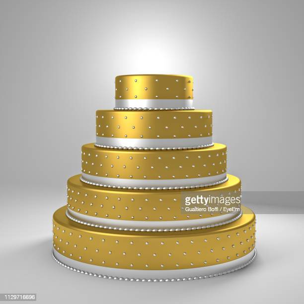 close-up of cake on table against gray background - wedding cake stock pictures, royalty-free photos & images